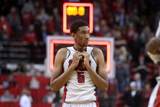 UNLV forward Christian Wood watches as UNR players celebrate in front of the UNLV student section after their Mountain West Conference basketball game Wednesday, Jan. 7, 2015, at the Thomas & Mack ...