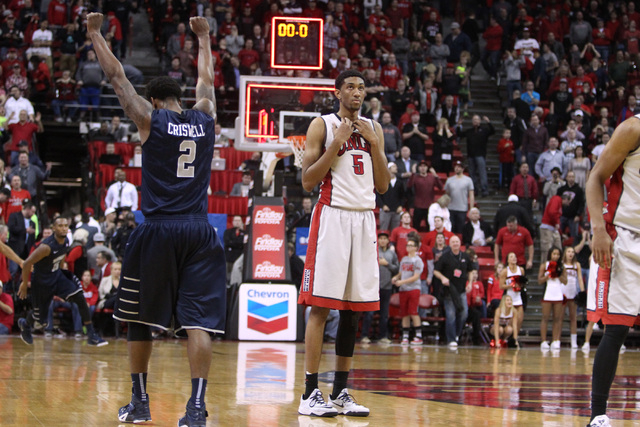 UNR guard Tyron Criswell throws his arms up in celebration while stunned UNLV forward Christian Wood watches the time expire during their Mountain West Conference basketball game Wednesday, Jan. 7 ...