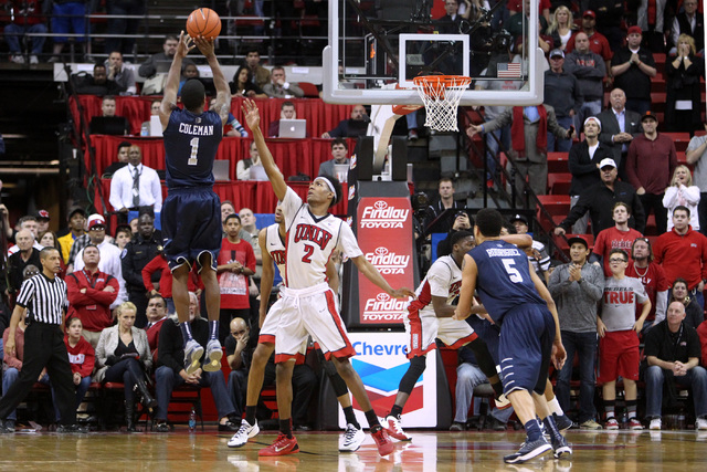 UNR guard Marqueze Coleman makes the game winning shot over UNLV guard Patrick McCaw during their Mountain West Conference basketball game Wednesday, Jan. 7, 2015, at the Thomas & Mack Center. UNR ...