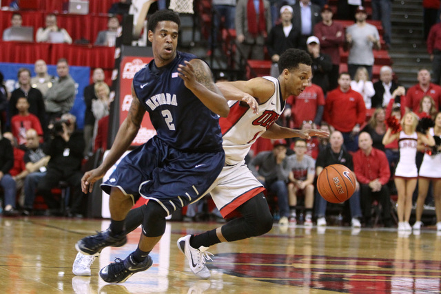 UNLV guard Rashad Vaughn dribbles around UNR guard Tyron Criswell during their Mountain West Conference basketball game Wednesday, Jan. 7, 2015, at the Thomas & Mack Center. UNR won the game 64-62 ...
