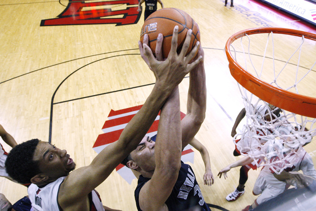 UNLV forward Christian Wood defend a shot by UNR forward A.J. West during their Mountain West Conference basketball game Wednesday, Jan. 7, 2015, at the Thomas & Mack Center. UNR won the game 64-6 ...