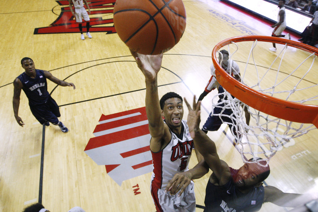 UNLV forward Christian Wood shoots over the top of UNR center Ronnie Stevens Jr. during their Mountain West Conference basketball game Wednesday, Jan. 7, 2015, at the Thomas & Mack Center. UNR won ...