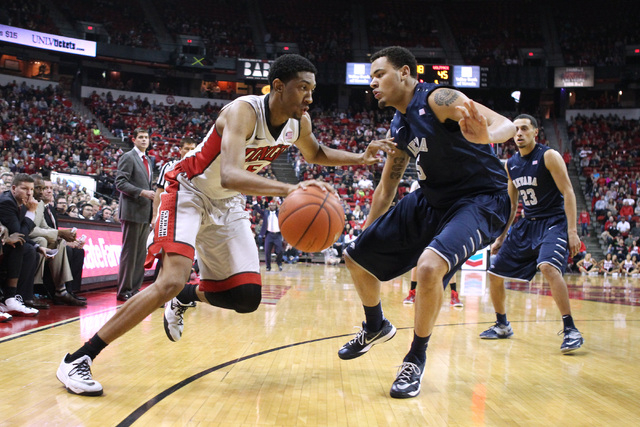 UNLV forward Christian Wood drives against UNR forward Kaileb Rodriguez during their Mountain West Conference basketball game Wednesday, Jan. 7, 2015, at the Thomas & Mack Center. UNR won the game ...