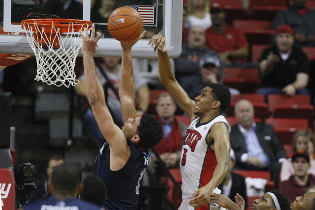 UNLV forward Christian Wood blocks a shot by UNR forward A.J. West during their Mountain West Conference basketball game Wednesday, Jan. 7, 2015, at the Thomas & Mack Center. UNR won the game 64-6 ...