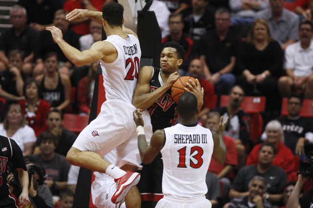 UNLV guard Rashad Vaughn grabs a rebound from San Diego State forward J.J. O'Brien during the second half of their Mountain West Conference game Saturday, Jan. 17, 2015, at Viejas Arena in San Die ...