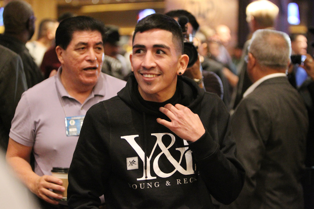 Leo Santa Cruz makes his way to the ring for a promotional event at the MGM Grand casino-hotel in Las Vegas Wednesday, Jan. 14, 2015. (Erik Verduzco/Las Vegas Review-Journal)