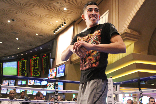 Leo Santa Cruz makes stretches before shadow boxing for fans during a promotional event at the MGM Grand casino-hotel in Las Vegas Wednesday, Jan. 14, 2015. (Erik Verduzco/Las Vegas Review-Journal)