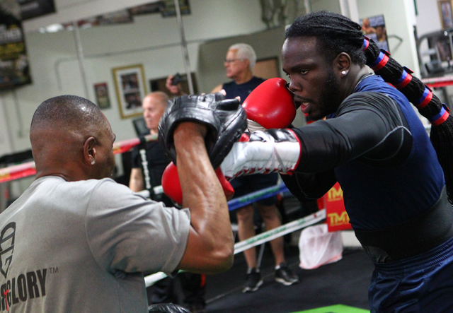 Boxer Bermane Stiverne, right, works out with his trainer Don House at Mayweather Boxing Club in Las Vegas on Friday, May 2, 2014. (Chase Stevens/Las Vegas Review-Journal)