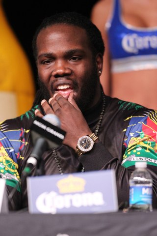Bermane Stiverne listens to his opponent Deontay Wilder speak during a press conference at the MGM Grand casino-hotel for his upcoming World Boxing Council heavyweight championship title Thursday, ...