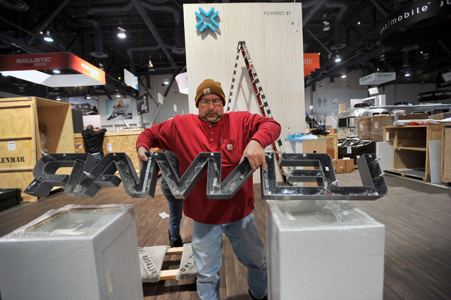 Perry Godzisz works to assemble a booth for CES at the Las Vegas Convention Center on Friday, Jan. 2, 2015, in Las Vegas. (David Becker/Las Vegas Review-Journal)