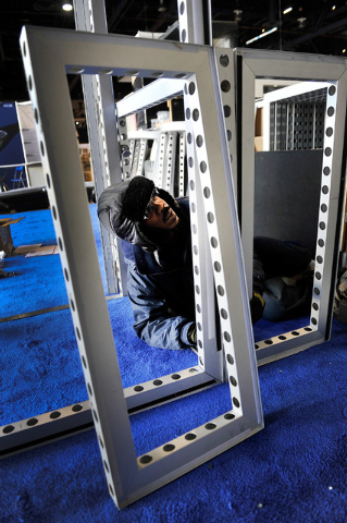 Robin Williamson works to assemble a booth for CES at the Las Vegas Convention Center on Friday, Jan. 2, 2015, in Las Vegas. (David Becker/Las Vegas Review-Journal)