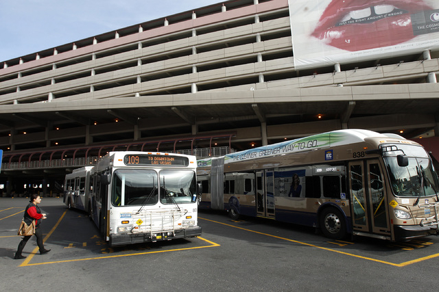 RTC busses make a stop at Terminal One at McCarran International Airport in Las Vegas Tuesday, Jan. 28, 2014. (John Locher/Las Vegas Review-Journal)