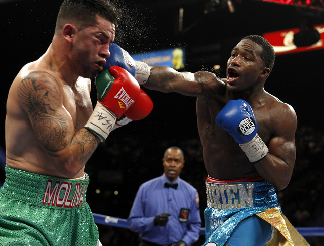 Adrien Broner hits Carlos Molina during their super lightweight title bout at the MGM Grand in Las Vegas Saturday, May 3, 2014. (Jason Bean/Las Vegas Review-Journal File)