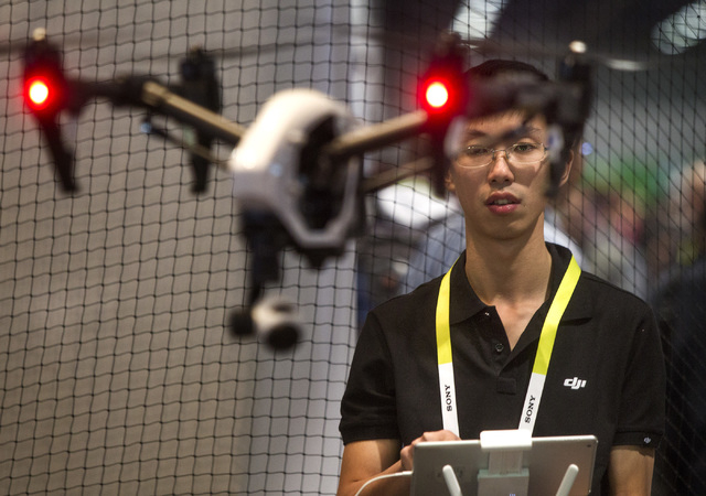Yuxiang Deng with DJI Innovations  operates an Inspire 1 droneTuesday, Jan. 6, 2015 during Consumer Electronic Show in the Las Vegas Convention Center. Around 160,000 people with 25% coming from o ...
