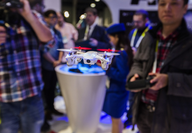 A Hubsan X4 Pro quadcopter is seen Tuesday, Jan. 6, 2015 during Consumer Electronic Show in the Las Vegas Convention Center. The drone is equipped with a video camera. Around 160,000 people with 2 ...