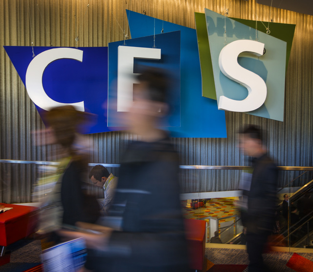 People walks beside a Consumer Electronic Show Tuesday, Jan. 6, 2015 at the Sands Expo. Around 160,000 people with 25% coming from overseas are attending the  four-day CES. (Jeff Scheid/Las Vegas  ...