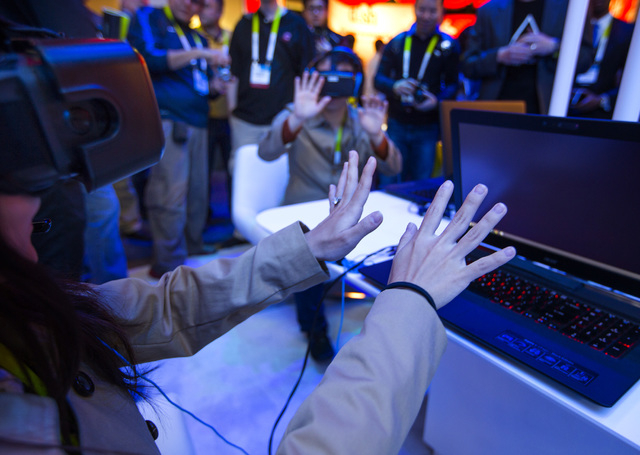 People interact with the Intel virtual reality demonstration  Tuesday, Jan. 6, 2015  during Consumer Electronic Show in the Las Vegas Convention Center. Around 160,000 people with 25% coming from  ...