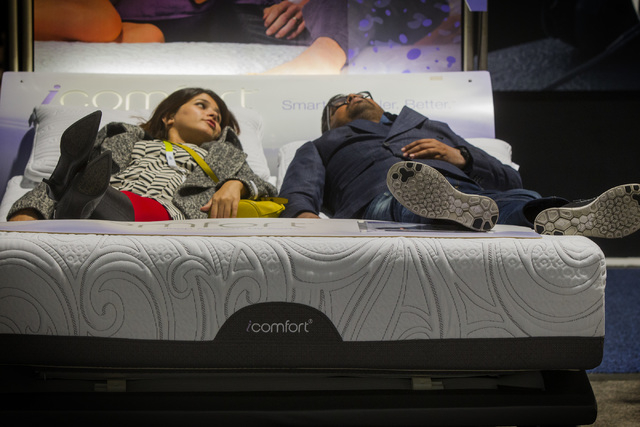 People try out a Serta IComfort mattress Tuesday, Jan. 6, 2015 during Consumer Electronic Show in the Las Vegas Convention Center. Around 160,000 people with 25% coming from overseas are attending ...
