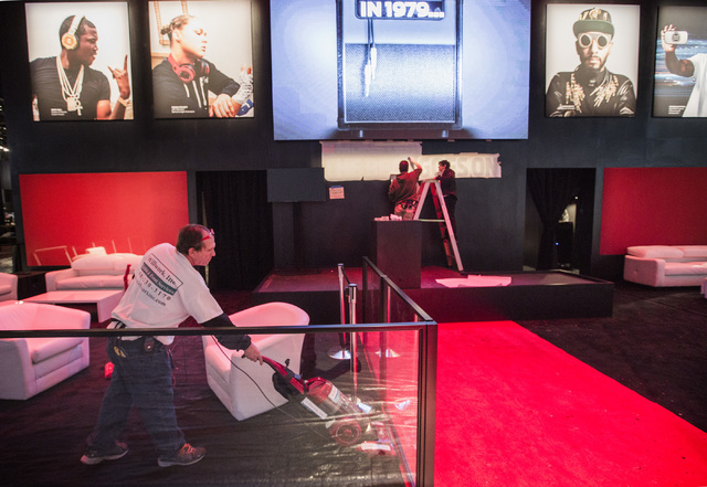 Anthony Bucci vacuums at the Monster booth in the Las Vegas Convention Center on Monday, Jan. 5, 2015. An estimate of 160,000 people will be attending the 2015 International Consumer Electronics S ...