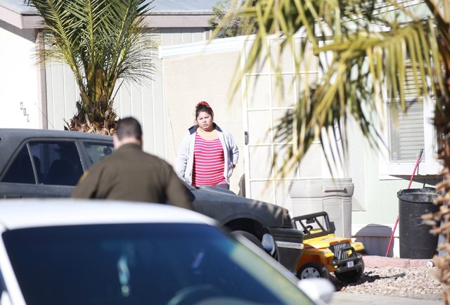 A woman waits to talk with a Las Vegas police officer at the scene of an incident involving a mother who backed into her 3-year-old child in a mobile home complex at the 6300 block of West Tropica ...