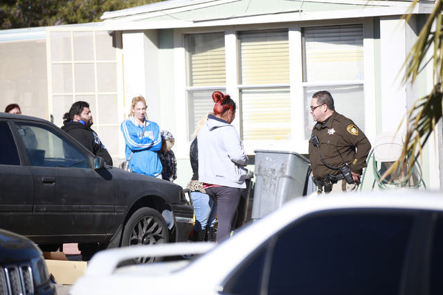 A woman speaks with a Las Vegas police officer at the scene of an incident involving a mother who backed into her 3-year-old child in a mobile home complex at the 6300 block of West Tropicana Aven ...