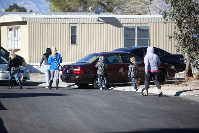 Multiple adults and children leave the scene of an incident involving a mother who backed into her 3-year-old child in a mobile home complex at the 6300 block of West Tropicana Avenue  on Wednesda ...