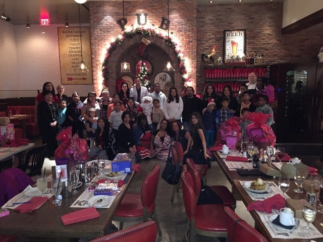 Todd English P.U.B. at The Shops at Crystals, 3720 Las Vegas Blvd. South, hosted about 40 children and their families from Communities In Schools of Nevada Dec. 18 for a holiday feast and gifts. S ...