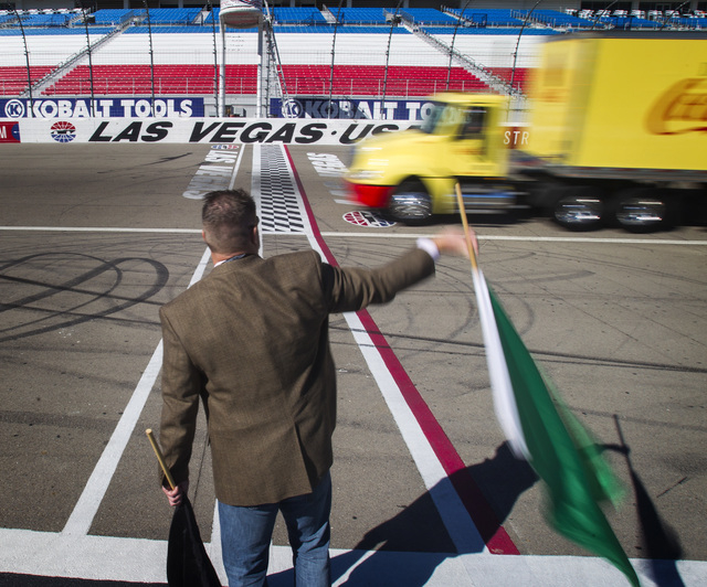 Brian Walsh, board member for the Las Vegas Chapter of Speedway Childrenճ Charities waves the green flag Thursday, Jan.15, 2015 during the  Laps for Charity fundraiser media event at the Las Vega ...