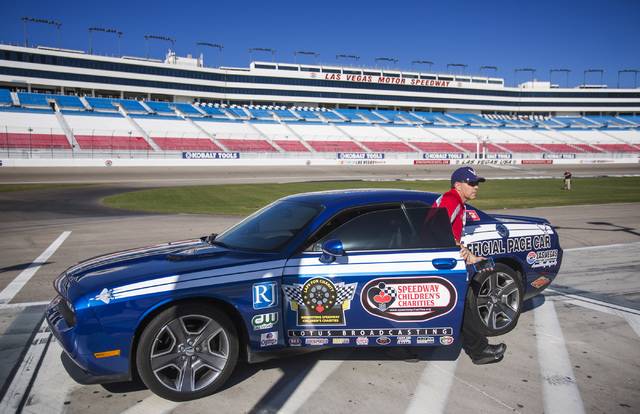 Brian Brown gets out of the  Las Vegas Chapter of Speedway Childrenճ Charities pace car Thursday, Jan.15, 2015 during Laps for Charity fundraiser media event at the Las Vegas Speedway,7000 North  ...