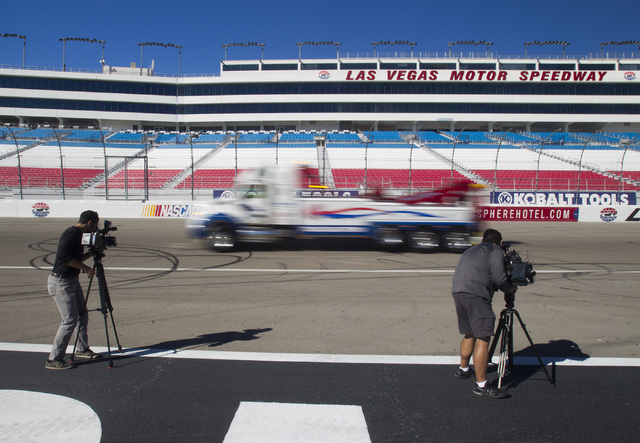 A wrecker from Big Valley Towing Trucks passes videographers  during the Las Vegas Chapter of Speedway Childrenճ Charities Laps for Charity fundraiser media event Thursday, Jan.15, 2015 at the La ...