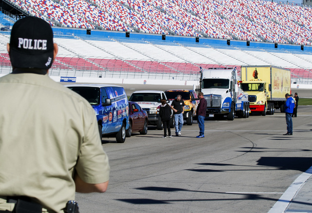 Vehicles line up during the Las Vegas Chapter of Speedway Childrenճ Charities Laps for Charity fundraiser media event Thursday, Jan.15, 2015 at the Las Vegas Speedway. (Jeff Scheid/Las Vegas Revi ...