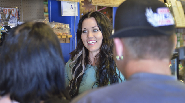 Lindsay Hogue, who runs the reception area and is part owner of the Coffee Cup Cafe, center, talks with long-time customers Sarah Morgan, left, and her husband James at the restaurant at 512 Nevad ...