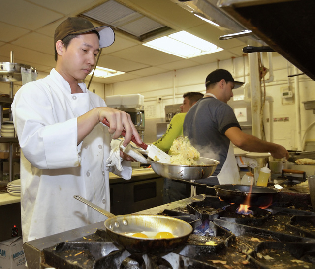Chef Jay Lavetoria prepares eggs in the kitchen of the Coffee Cup Cafe in Boulder City on Saturday, Jan. 24, 2015. (Bill Hughes/Las Vegas Review-Journal)
