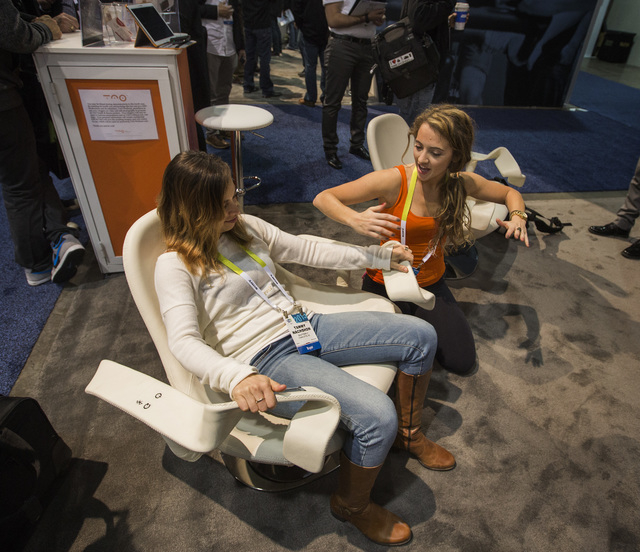 Genevieve Schettino,right, with TAO-Wellness, explains the new Tao wellness chair to Tammy Nachshon during the Consumer Electronic Show Digital Health Summit at the Sands Expo on  Tuesday, Jan. 6, ...