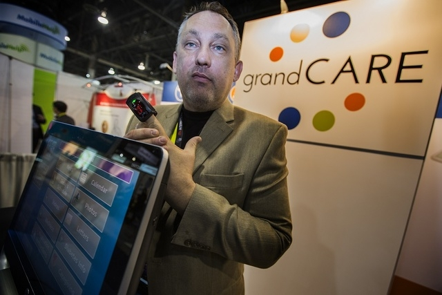 Scott Feldstein, director of of product management at Grand Care System, gives a product demonstration Tuesday, Jan. 6, 2015 during the Consumer Electronic Show Digital Health Summit at the Sands  ...