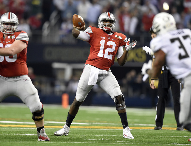 Ohio State Buckeyes quarterback Cardale Jones (12) throws a pass during the fourth quarter against the Oregon Ducks in the 2015 CFP National Championship Game at AT&T Stadium on Jam. 12. (Tommy Gi ...