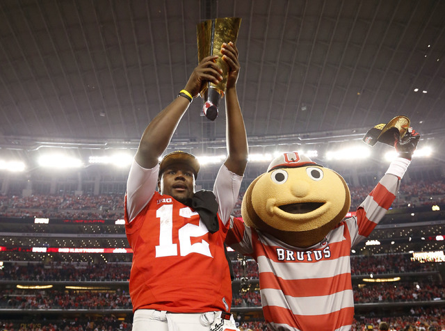 Ohio State Buckeyes quarterback Cardale Jones (12) hoists the championship trophy after the 2015 CFP National Championship Game against the Oregon Ducks at AT&T Stadium. (Matthew Emmons-USA TODAY  ...