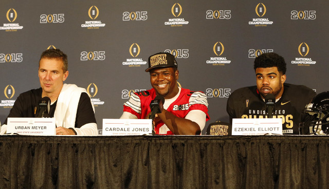 Ohio State Buckeyes head coach Urban Meyer, quarterback Cardale Jones (12) and running back Ezekiel Elliott (15) during a press conference after beating the Oregon Ducks in the 2015 CFP National C ...