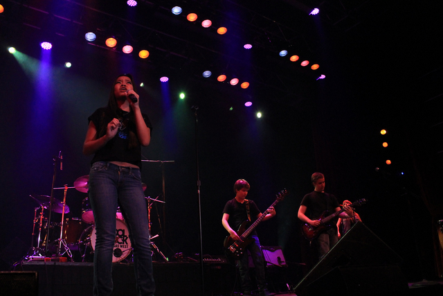 School of Rock students Natasha Romero-Salas, left, Connor Davis, center, and Alex Rea, right, perform in an AC/DC tribute show in September at the South Point. (Special to View)