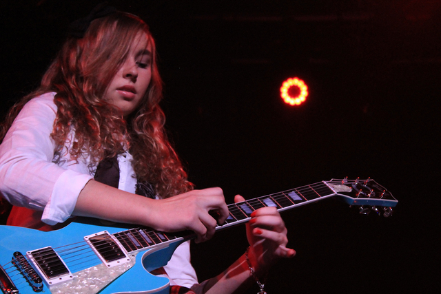 School of Rock student Natalie Robertson plays the guitar in an AC/DC tribute show in September at the South Point. (Special to View)