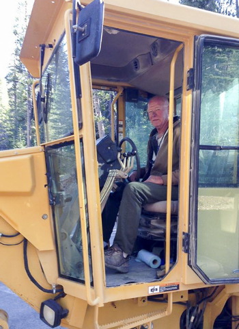 Chuck Caha, pictured here on a piece of road equipment, is the only Death Valley National Park employee ever to die as a result of extreme heat in the park. His death in 2013 has sparked new safet ...