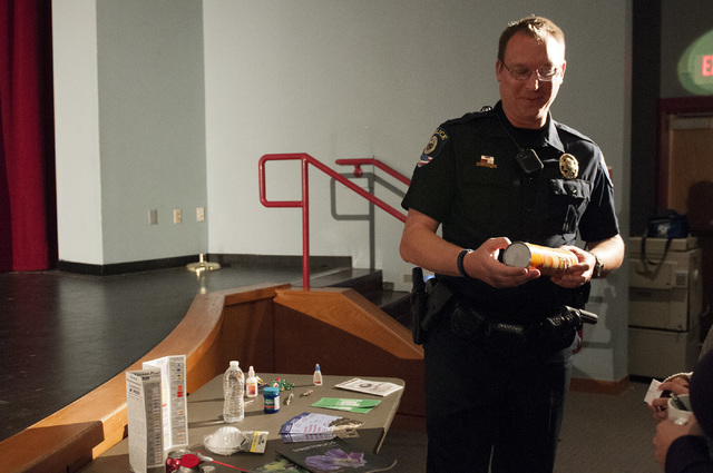 Steven Ufford, a Clark County School District Police Department officer, demonstrates how some students use common items as drugs during a forum Nov. 13, 2013, at Western High School. (Erik Verduz ...