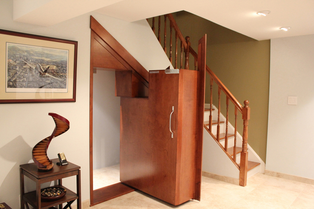 "Creative Home Engineering A trade secret to building an ensconced enclosure in a home is to utilize the ""dead"" space in a home, which can often be found underneath a staircase."