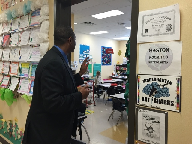 Principal Reggie Farmer waves to kindergarten students at the Somerset Academy of Las Vegas Stephanie Campus, 50 N. Stephanie St. The campus opened in August and teaches kindergarten through eight ...