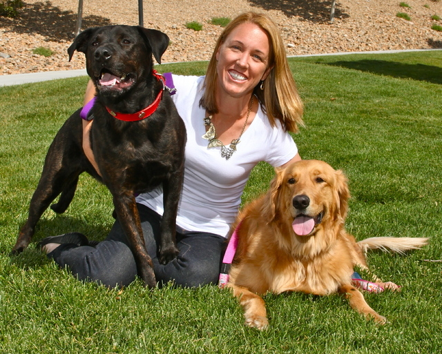 Michael's Angel Paws founder Stephanie Gerken poses with Sheasta, left, and Freedom, right. Gerken trained Freedom to become a service dog and gifted him to Army veteran Tony Ray Silva in December ...