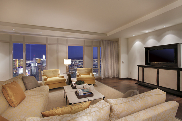A gathering space in the southeast part of the The Mandarin Oriental penthouse features a flat-screen entertainment system created by JBL. Hidden motors automatically lift the display screen up an ...