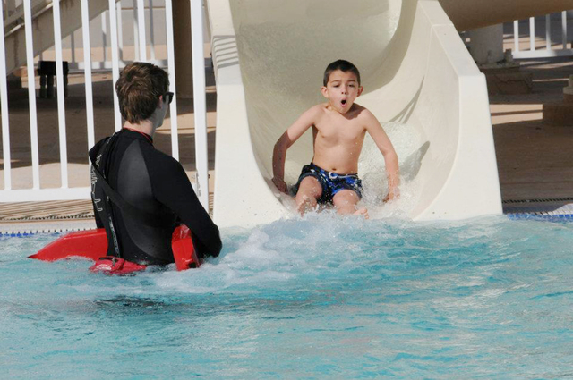 A child slides into the pool during the city of Henderson's 2012 Polar Bear Plunge. The event is set to return from noon to 3 p.m. Jan. 10 at the Whitney Ranch Aquatic Complex, 1575 Galleria Drive ...