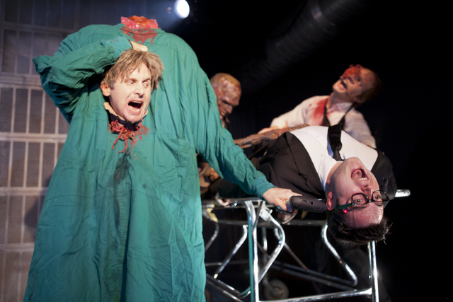 "Dr. Carl Hill (Jesse Merlin), left, and medical student Herbert West (Graham Skipper), backed by Marlon Grace and Brian Gillespie, share the mayhem in ""Re-Animator the Musical."" (Thomas Hargis/Cou ..."