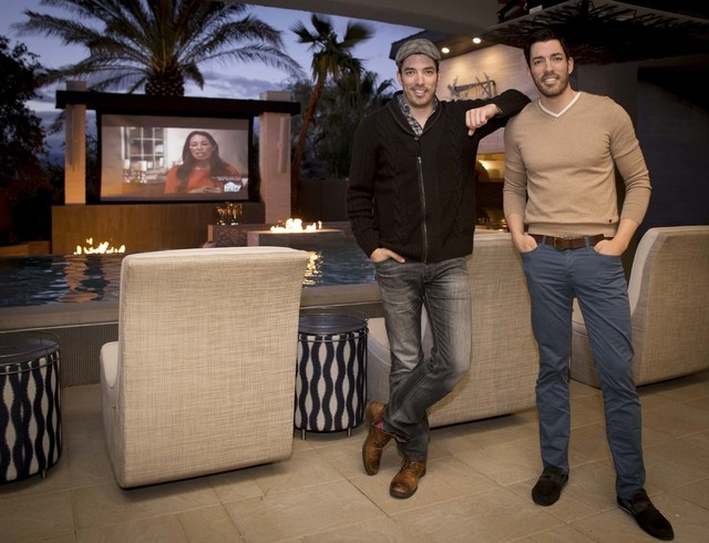 "Drew and Jonathan and Scott, who star on the HGTV's ""Property Brothers,"" relax in their Las Vegas home.  (Tonya Harvey/Real Estate Millions)"