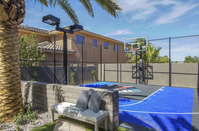 Drew and Jonathan Scott installed a basketball court in the backyard of their Las Vegas home. (Courtesy)